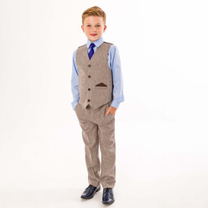 Boy wearing tweed trousers and waistcoat