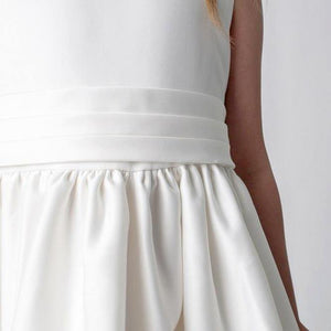 White sash on girls dress