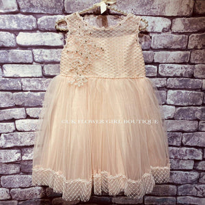 Pretty Flower Girl Dress against brick wall background