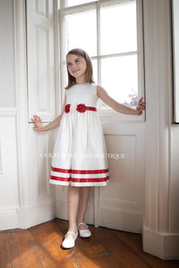 Pretty girl wearing beautiful dress by window