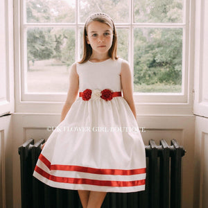 Girl wearing white and red dress