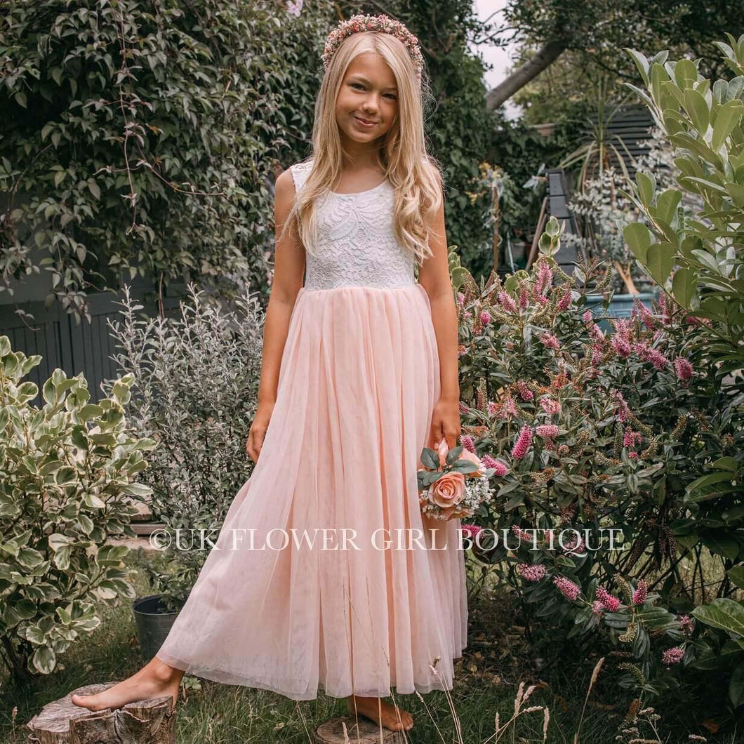 Girl wearing blush pink dress