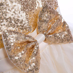 gold sequin bow on dress