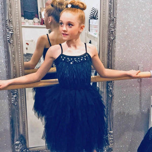 Girl wearing black ballerina style dress
