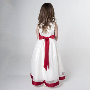 Girl in white and red flower girl dress