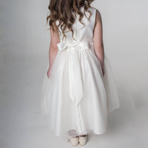 bow on back of white dress
