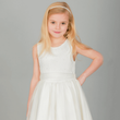 Blonde girl wearing ivory coloured party dress