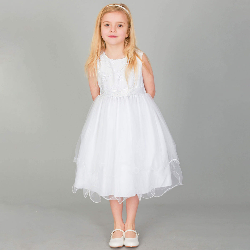 Girl wearing white Tiffany Flower Girl dress