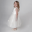 Lilly Dress in ivory being modelled by girl