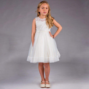 girl modelling Ivory Phoebe - Ribbons and Lace Dress by UK Flower Girl Boutique