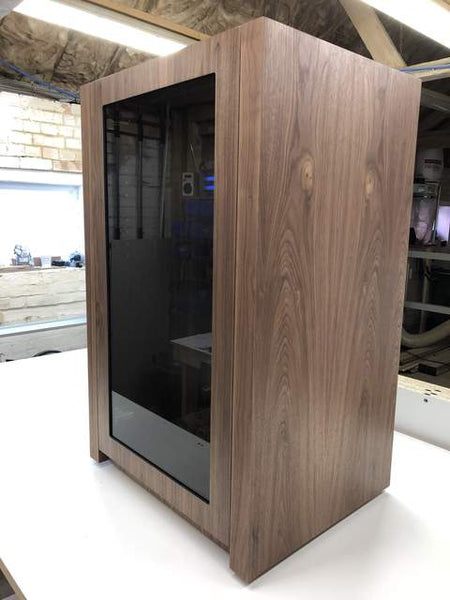 AV Cabinets in wood by Audinni with walnut finish and glass door