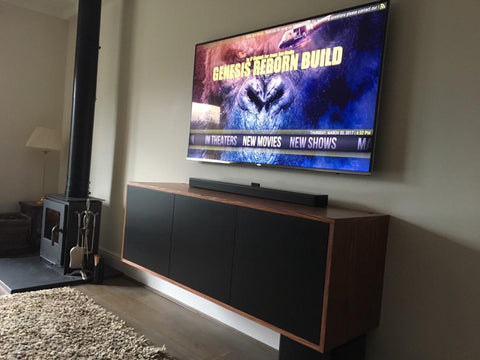 Home cinema furniture integrated into wall, hovering wooden TV Cabinet