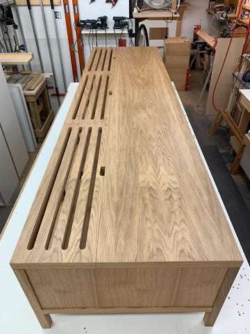 Large AV Cabinet in light wood with ventilation slots in handmade wood, made in the UK