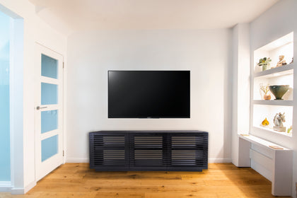 Audinni Linear Trio Large AV Cabinet below TV in home with white walls