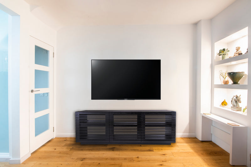 Audinni Linear Trio Large AV Cabinet handmade in the UKbelow TV in home with white walls