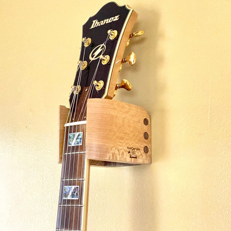 Audinni and Axe Dangler Guitar Wall Mount Cuff holding guitar