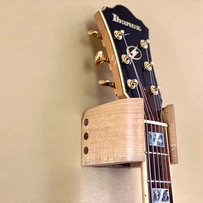 Audinni Guitar Wall Mount Cuff holding guitar