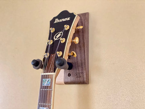 Audinni Guitar Wall Mount String-Swing holding guitar