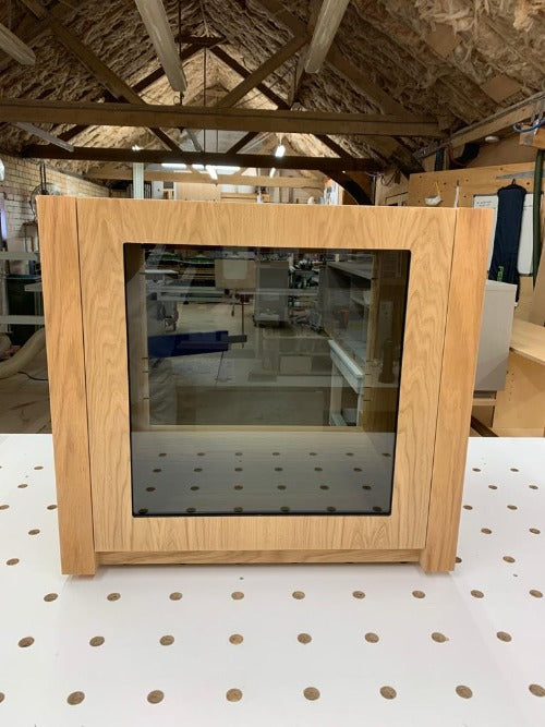 Aveos Cube front wooden AV Cabinet view with glass door - Audinni