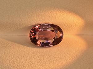 8800656-oval-lustrous-greyish-pink-changing-to-purplish-pink-igi-madagascar-natural-color-change-sapphire-2.35-ct