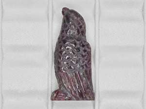 8801457-carved-dark-purple-red-gii-sierra-leone-natural-ruby-46.04-ct