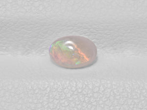 8801428-cabochon-very-light-brown-with-multi-color-flashes-igi-australia-natural-white-opal-0.28-ct