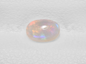 8801436-cabochon-light-yellow-with-multi-color-flashes-igi-australia-natural-white-opal-0.33-ct