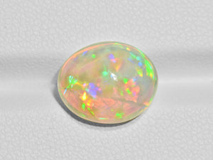 8801573-cabochon-brownish-yellow-with-multi-color-flashes-igi-ethiopia-natural-white-opal-5.14-ct