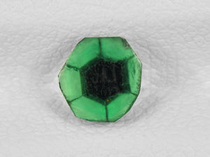 8802144-cabochon-intense-green-with-black-spokes-igi-colombia-natural-trapiche-emerald-0.56-ct