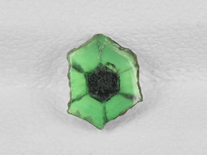 8802150-cabochon-lively-green-with-black-spokes-igi-colombia-natural-trapiche-emerald-0.57-ct