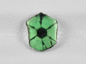 8802163-cabochon-lively-green-with-black-spokes-igi-colombia-natural-trapiche-emerald-0.64-ct