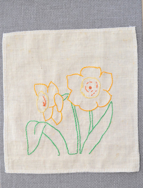Daffodil embroidery that was started by the grandmother of Amy Reader - a fiber artist in Charlotte, NC