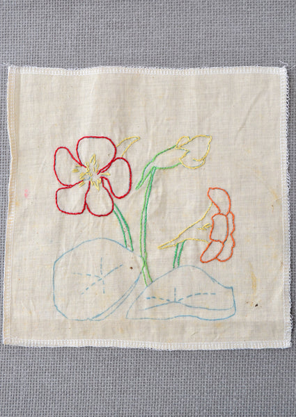 Nasturtium flower embroidery started by the grandmother of Amy Reader - a fiber artist in Charlotte, NC.