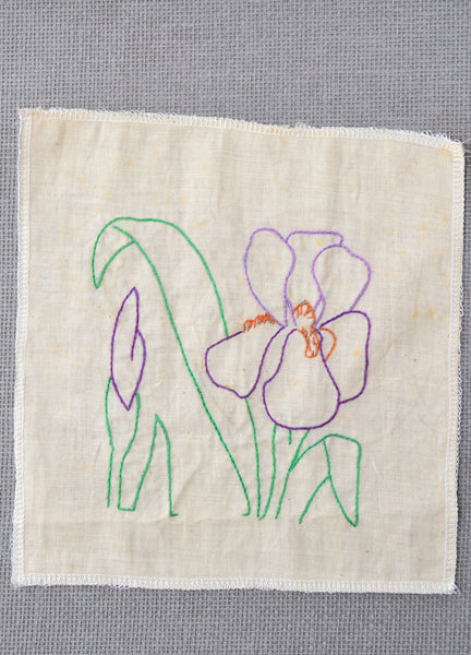 Partially complete orchid embroidery that was started by the grandmother of Amy Reader.