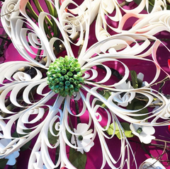 Detail shot of a hand quilled dogwood flower in the spring 2017 Anthropologie window in North Carolina created by Amy Reader