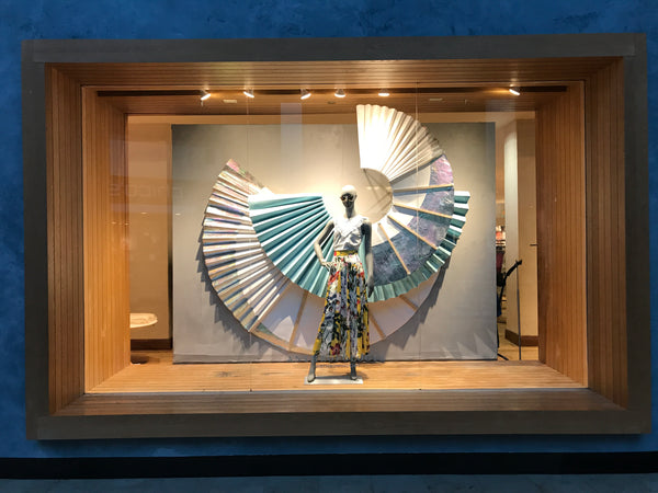 Summer 2018 sail inspired window created using pleated paper and a wooden structure by Amy Reader for a North Carolina Anthropologie