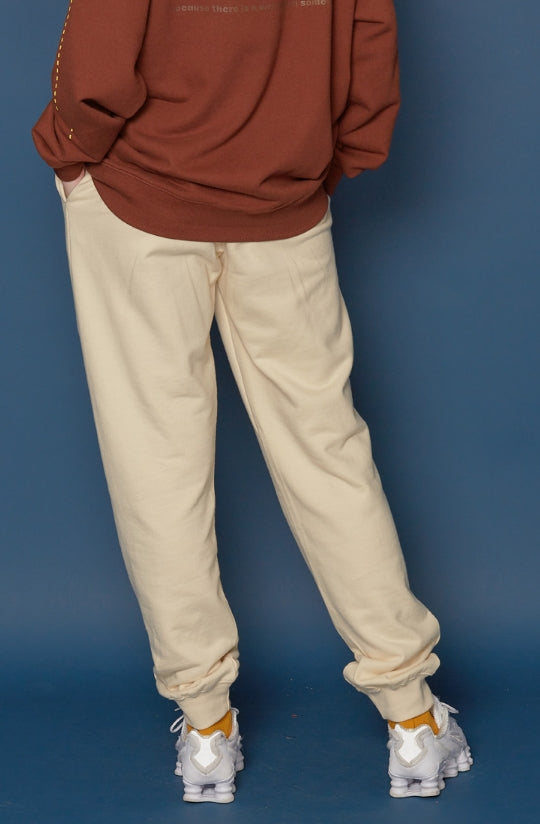 スローアシッド(SLOW ACID) Leather Patch Sweatpants (IVORY)