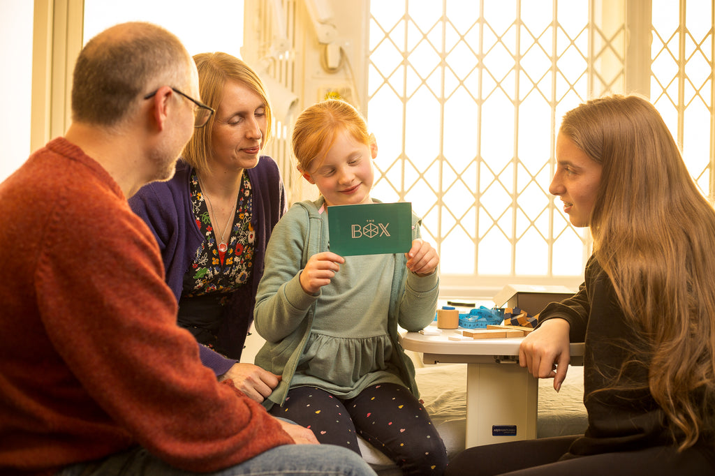 A family enjoying The Box in hospital