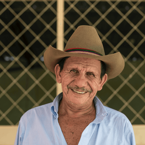 Farmer smiling in a cool hat