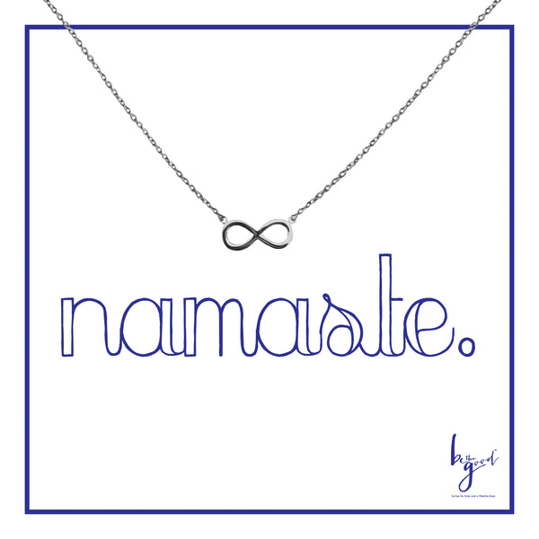 Silver infinity charm necklace on namaste card