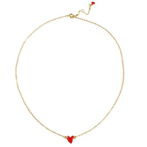 Red enamel heart charm necklace on gold chain.