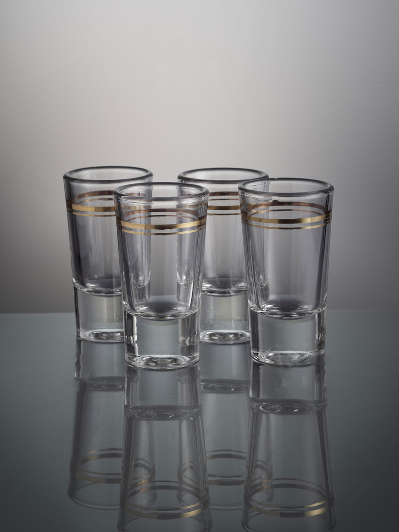 Four shot glasses