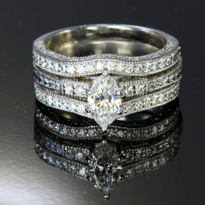 14 Karat Wedding Set .56 Carat Marquise Diamond