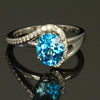 18K White Gold Oval Blue Zircon and Diamond Ring