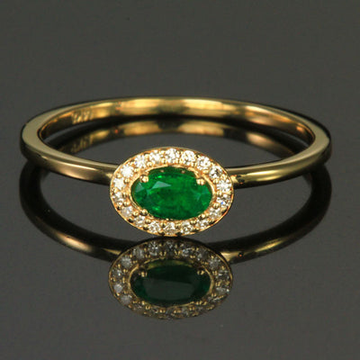 14K Yellow Gold Oval Emerald Ring with Halo of Diamonds