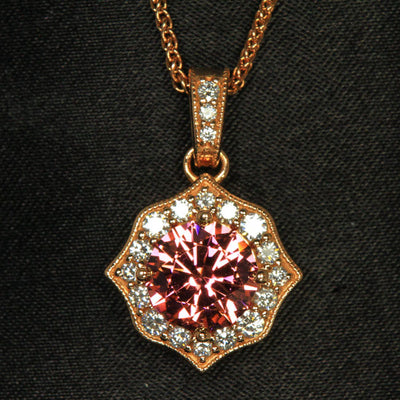 14k Rose Gold Round Mahenge Garnet Pendant with Halo of Diamonds