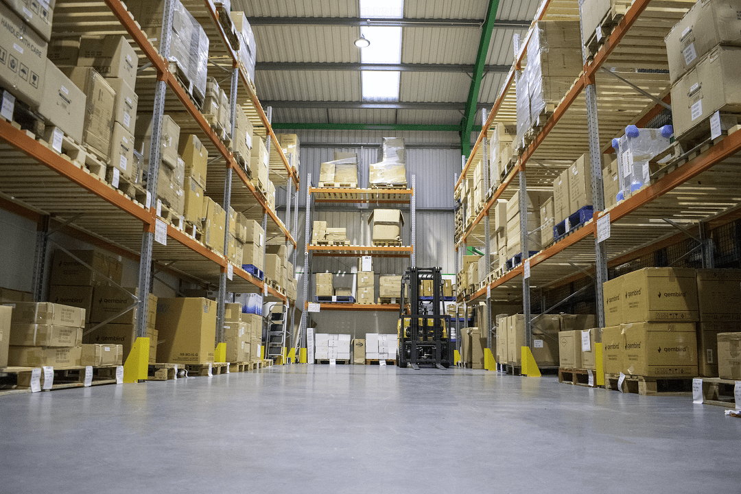 i-choose ltd business photo of warehouse with stock and forklift truck