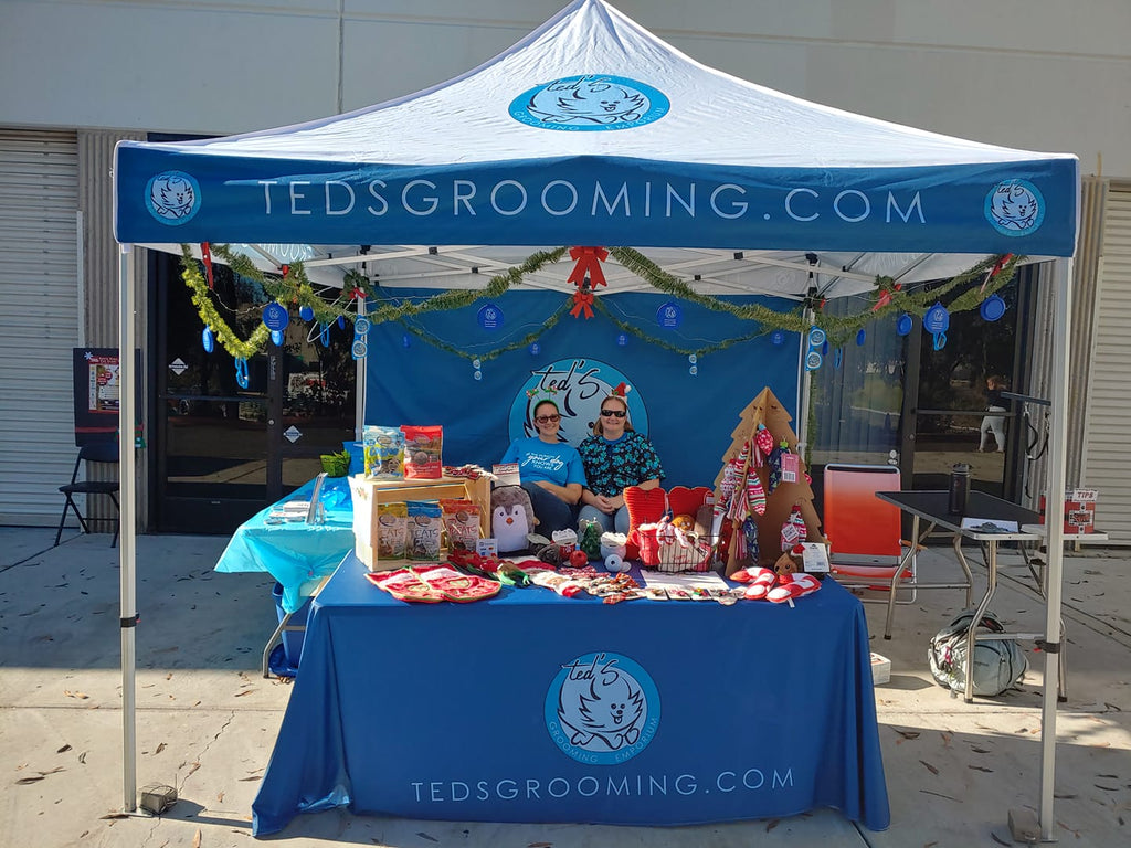 The Ted's Grooming booth at Santa Paws Pup Crawl
