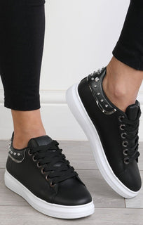 Black-studded-back-trainers–livvy