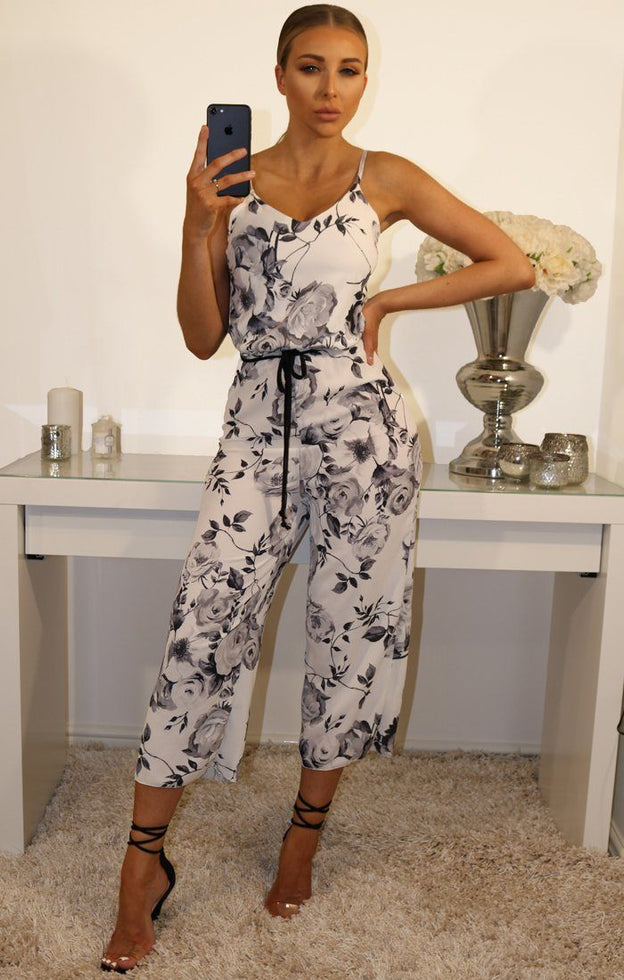 BLACK AND WHITE FLORAL TIE WAIST JUMPSUIT